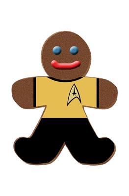 Gingerbread man dressed up in a gold command star trek uniform a la