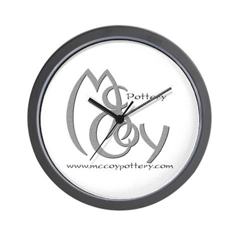 McCoy Pottery Black Wall Clock by CafePress