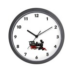 Train collectibles clock with red and black classic railroad engine.