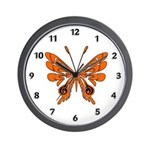 Butterfly Wall Clock with a flame tattoo type of design.