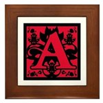 The letter A, in scarlet. One of the original bad girl symbols.