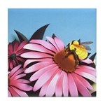 Stunning sculpted paper illustration of bee on pink echinacea flower.